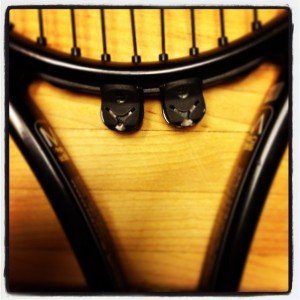String Advantage Pojie installed on a Mantis Pro 295 tennis racket